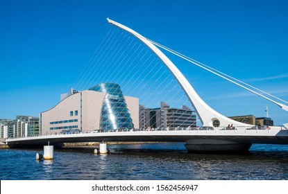 DUBLIN, IRELAND, - APRIL, 21, 2018: The Samuel Becket Bridge in Dublin, Ireland with the National Convention Centre in the background.