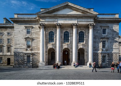 DUBLIN, IRELAND - APRIL 22, 2016: Front view of Chapel building at the Parliament Square at Trinity Collage in Dublin Ireland April 22, 2016. Incidental people in the foreground.