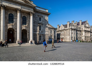 DUBLIN, IRELAND - APRIL 22, 2016: Side view of Parliament Square with Chapel building at Trinity Collage in Dublin Ireland April 22, 2016. Incidental people in the foreground.