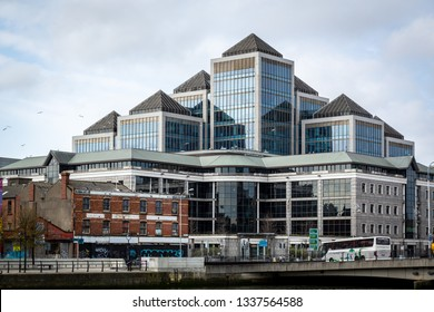 DUBLIN, IRELAND - APRIL 22, 2016: Outdoor exterior front view of a large office complex with glass facade in the shape of a pyramid in Dublin Ireland April 22, 2016.