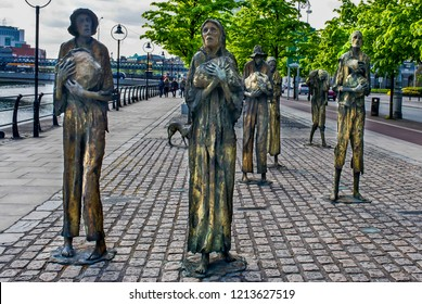 Dublin, Ireland - April, 26, 2011:The Famine Memorial sculpture was created by Rowan Gillespie and unveiled in 1997. A memorial to the many people who emigrated because of Ireland's Great famine.