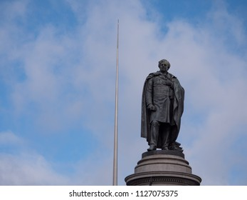 Dublin, Ireland - April 7th 2016: Statue of Daniel O'Connell with Spire of Dublin behind, on O'Connell Street, Dublin, Ireland