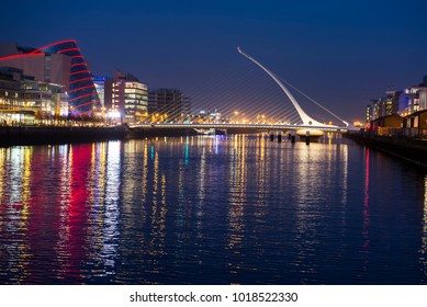 Dublin, Ireland - April 9, 2015. Night view of the Docklands area with the Samuel Beckett bridge on the right, and the convention center on the left.