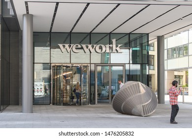 DUBLIN, IRELAND - AUG 02, 2019: A worker enters the WeWork office building on Harcourt Road, Dublin.
