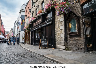 DUBLIN, IRELAND - AUGUST 10; Tourists, wander the streets of Temple Bar area a popular travel destination with quaint old buildings, bars and shops August 10, 2017, Dublin, Ireland.