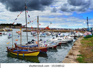 DUBLIN, IRELAND - AUGUST 11: Boats moored at Bulloch Harbour during The Blessing of the Boats on August 11, 2013 in Dalkey, Ireland. The annual event raises funds for the RNLI.