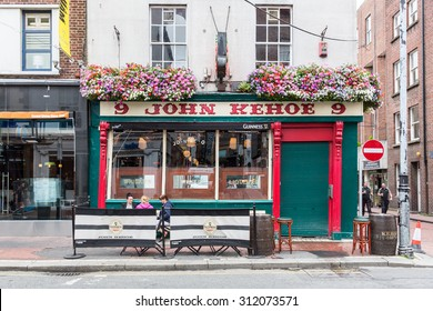 DUBLIN, IRELAND - AUGUST 14, 2015: The John Kehoe public house. It is a traditional Irish pub in Victorian style with stained glass mahogany doors and snug partitions. It was first licensed in 1803.