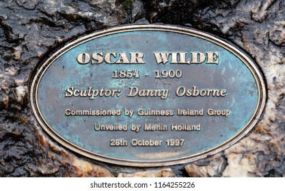 Dublin, Ireland August 17, 2018: Sculpture of writer Oscar Wilde in Merrion Square. The artwork by Danny Osborne was unveiled in 1997. The art shows Wilde reclining on a large boulder.
