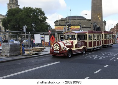 Dublin, Ireland - August 19, 2014: Tourist train in the center of Dublin.