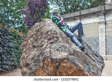 DUBLIN, IRELAND - AUGUST 19, 2019: Photo of Sculpture of Oscar Wilde.