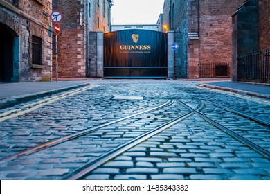 Dublin, Ireland - August 2019: Low angle shot of the closed entrance to the Guinness Brewery at St. James's Gate with an empty cobblestone street