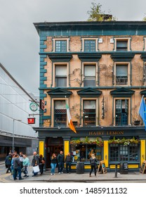 Dublin, Ireland - August 2019: People outside The Hairy Lemon, one of Dublin's numerous pubs on a cloudy day
