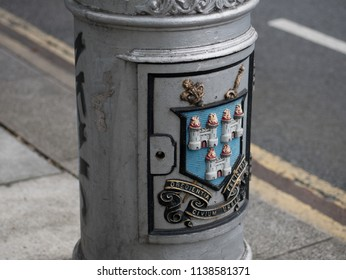 Dublin, Ireland - August 21st 2016: Old Street lamp in Dublin. Close up of Dublin City coat of arms in colour with the Latin motto Obedientia Civium Urbis Felicitas