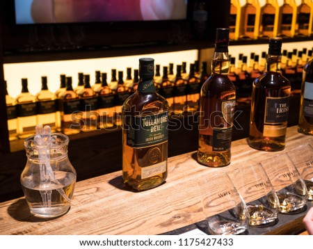 DUBLIN, IRELAND - AUGUST 22, 2018: The Dublin Whiskey Museum explains history of Irish Whiskey and invites to taste a few of them