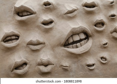 DUBLIN, IRELAND - AUGUST 24, 2013: Closeup of lips on a sand sculpture in the Upper Yard in Dublin Castle in Dublin, Ireland