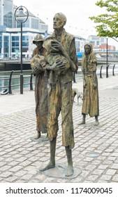DUBLIN, IRELAND- August 28th, 2018: Monument to the Potato famine in Ireland alongside the River Liffey in Dublin.