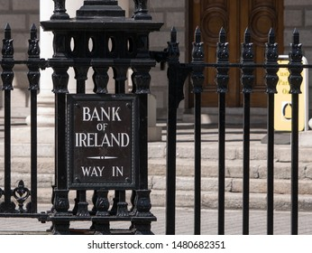 Dublin, Ireland - August 3 2017: Entrance sign and door of Bank of Ireland. Metal railings and Way In written on sign.
