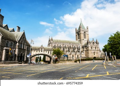 Dublin, Ireland. Car traffic with the Christ Church Cathedral during the sunny day in Dublin, Ireland. Cloudy sky