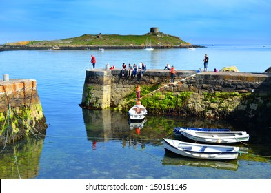 DUBLIN, IRELAND - CIRCA JUNE: Coliemore Harbour with Dalkey Island in the background circa June, 2013 in Dalkey, Ireland. The Martello fort on the island was built in 1804.
