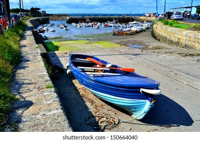DUBLIN, IRELAND - CIRCA JUNE: A wooden rowing boat sits on the slipway at Bulloch Harbour circa June 2013 in Dalkey, Ireland. Bulloch Harbour was Ireland's main port in Medieval times.