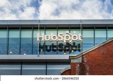 Dublin, Ireland - December 2020 : Close up photo of HubSpot sign on office building located in Dublin Docklands area at the bank of River Liffey