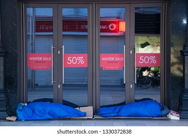 DUBLIN, IRELAND - DECEMBER 24, 2014: Homeless people sleep on the streets of Dublin city on Christmas day.