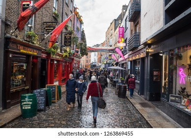 Dublin, Ireland - December 8, 2018: Crowd of People in Temple Bar Street in Old Town near the Famous Temple Bar Pub. Temple Bar is a busy riverside neighbourhood Dublin City Centre.