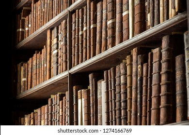 DUBLIN, IRELAND - FEB 15, 2014: Vintage library with shelves of old books in the Long Room in the Trinity College.
