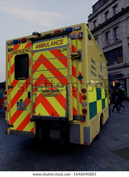 DUBLIN, IRELAND - FEBRUARY 14, 2020: A back view of the Emergency Ambulance truck parked in Dublin city center. Street view. Cloudy winter afternoon.