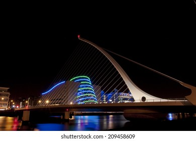 Dublin, Ireland - February 21, 2014: Samuel Beckett Bridge, with Convention Center in the background, overlooking Liffey River at nighttime