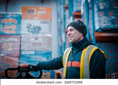 Dublin, Ireland - February 27th 2018: Factory worker moving boxes in warehouse