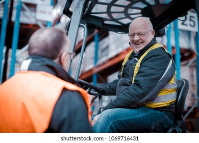 Dublin, Ireland - February 27th 2018: Forklift driver in discussion with manager on factory floor