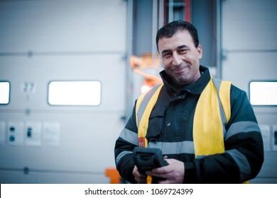 Dublin, Ireland - February 27th 2018: Happy worker in hi vis jacket on factory floor