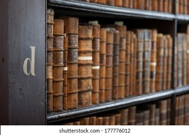 Dublin, Ireland - January 03, 2014: Shelves in The Long Room in Trinity College Library. Measured at almost 65 metres long and It is the permanent home to the famous Book of Kells. business
