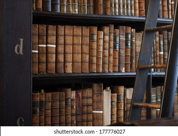 Dublin, Ireland - January 03, 2014: Shelves in The Long Room in Trinity College Library. Measured at almost 65 metres long and It is the permanent home to the famous Book of Kells. Business.