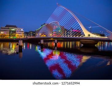 Dublin, Ireland - January 1, 2019: Long exposure of Samuel Beckett Bridge in Dublin (with Convention Center in Background)