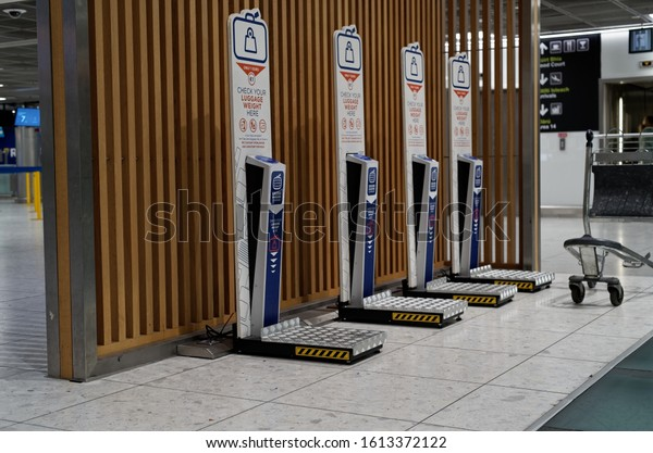 DUBLIN, IRELAND - JANUARY 11, 2020: Row of self service scales to check luggage weight at the empty hall in Dublin Airport.