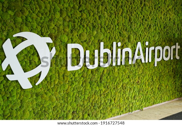 DUBLIN, IRELAND - JANUARY 15, 2020: Dublin Airport logo and name mounted on the living green wall. The vertical garden greets passengers at the entrance of the Terminal 1.