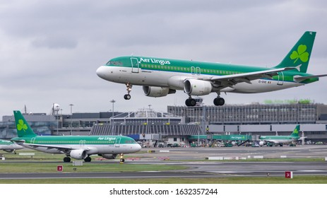 Dublin, Ireland / January 2020: Aer Lingus, A320, landing and preparint to take off at the same time at Dublin airport.