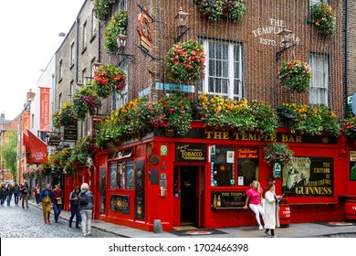 DUBLIN, IRELAND - JULY 1, 2019: Temple Bar is a famous landmark in Dublins cultural quarter visited by thousands of tourists every year. The Temple Bar in the center of the Irish capital