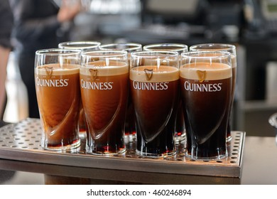 DUBLIN, IRELAND - JULY 12, 2016: Pints of Guinness in the  museum in Dublin. Guinness is an Irish dry stout produced by Diageo originated in the brewery of Arthur Guinness