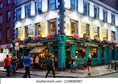 DUBLIN, IRELAND - JULY 12, 2018: Front view of an old colorful facade of the building. Old restaurant and pub in the city centre of Dublin, Ireland.