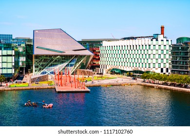 DUBLIN, IRELAND - JULY 18, 2017: Aerial view of Grand Canal docks in Dublin, Ireland in the morning. Crowded streets and modern buildings, blue clear sky