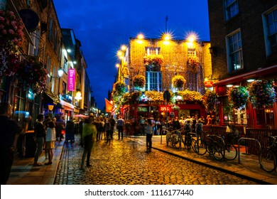 DUBLIN, IRELAND - JULY 19, 2017: Nightlife at popular historical part of the city - Temple Bar quarter in Dublin, Ireland. The area is the location of many bars, pubs and restaurants