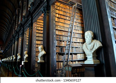 Dublin, Ireland, July, 2016. Bookshelf and Sculptures inside the Old Library, Trinity College Dublin, which is famous for The Book of Kells.