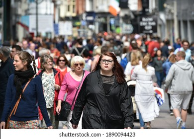 Dublin, Ireland - July 22, 2015: Crowds of people walk on the landmark Grafton Street. The street is a main tourist attraction in the Irish capital, renowned for its lively atmosphere and many shops.