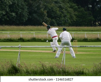 Dublin, Ireland - July 2nd 2016: Two men playing cricket wearing cricket whites, in Phoenix Park, Dublin, Ireland