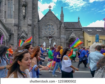 Dublin, Dublin / Ireland - June 24 2017: People marching in front of a church in Dublin gay pride, June 24 2017 Pride marks overcoming inequalities and injustice and festival has become a celebration