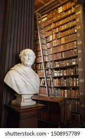 Dublin, Ireland - June 24, 2019: The Long Room interior Of The Old Library At Trinity College. Marble busts of great people and shelves with antique tomes