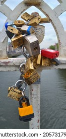 DUBLIN, IRELAND - JUNE 26: Love Padlocks inscribed with names attached to the railings of Dublin city's historic Ha'penny Bridge on June 26, 2014 in Dublin, Ireland.